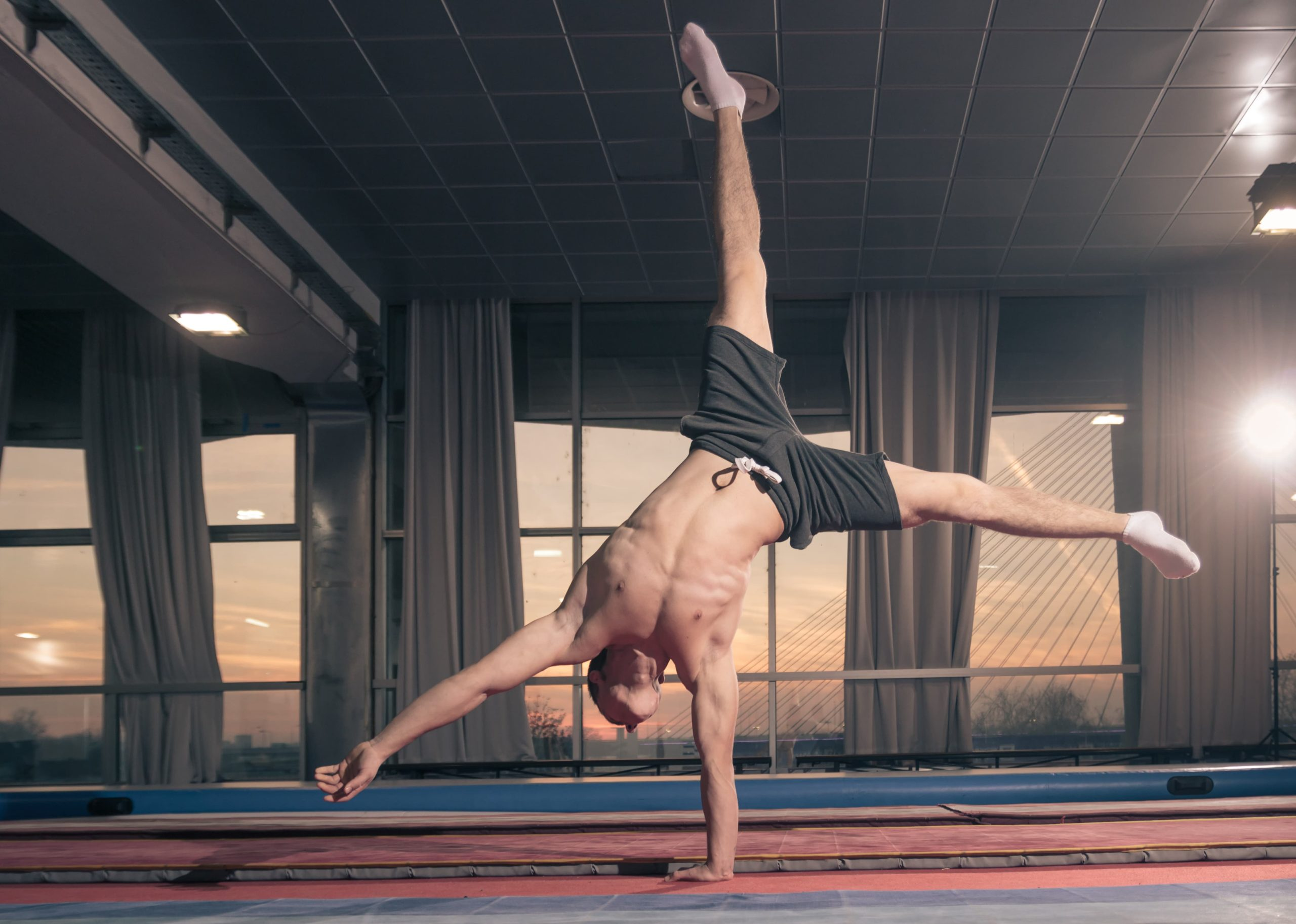 Man doing some acrobatic moves that demand focus, mental clarity and physical energy.